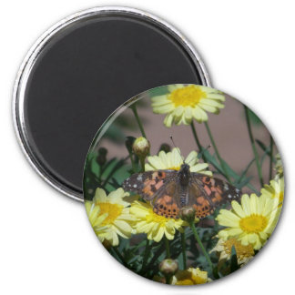 Butterfly with yellow flowers round magnet