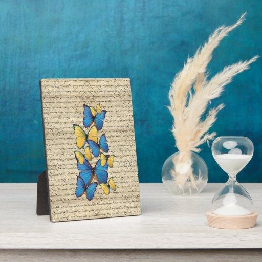 Butterrflies azules y amarillos placas para mostrar
