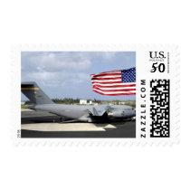 C-17 Globemaster III sits on the flightline Postage