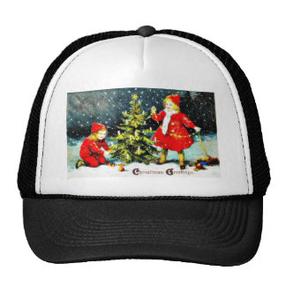 c a boy and a girl decorating christmas tree trucker hat