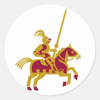 Caballero a caballo pegatina redonda