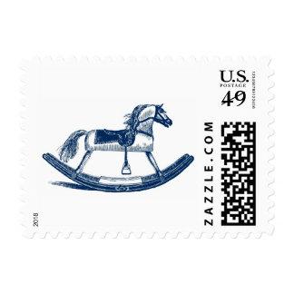 Caballo mecedora azul sellos