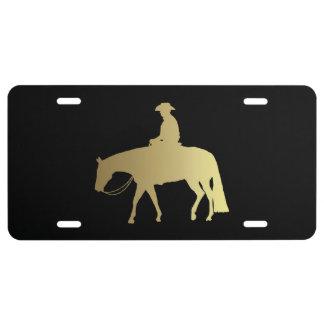 Caballo occidental de oro del placer en negro placa de matrícula