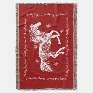 Caballo rojo y blanco del navidad del copo de manta