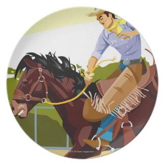 Caballo salvaje bucking del montar a caballo del platos de comidas