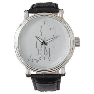 Caballo y jinete elegantes de la silueta del relojes de mano