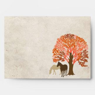 Caballos del otoño del naranja y de Brown Sobre