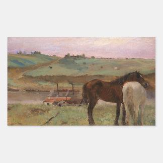 Caballos en un prado pegatina rectangular
