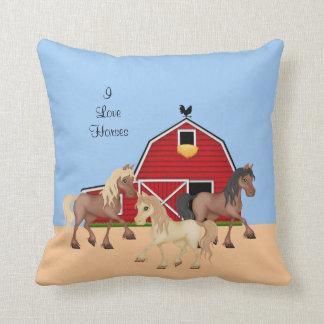 Caballos en una granja cojín
