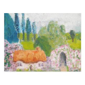 Cabaña color de rosa cubierta con paja postales