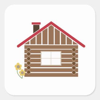 Cabaña de madera pegatina cuadrada