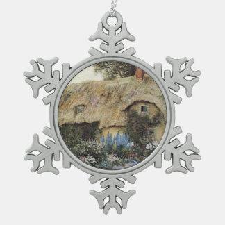 Cabaña del país del vintage con el jardín de adorno de peltre en forma de copo de nieve