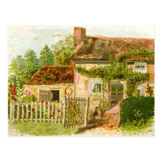 Cabaña encantadora de la chimenea con la valla de tarjeta postal
