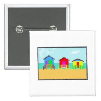 Cabañas coloridas de la playa en la línea de la pl pins