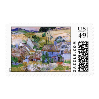Cabañas cubiertas con paja por una colina de sello