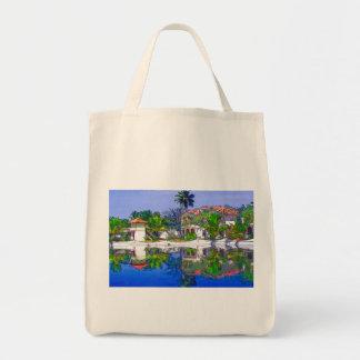 Cabañas y laguna hermosas bolsas de mano