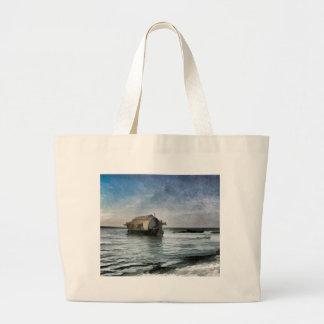 Cabañas y laguna hermosas bolsas