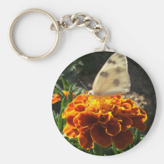 Cabbage white butterfly on a marigold keychain