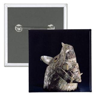 Cabeza de un animal con la cabeza humana en mandíb pin
