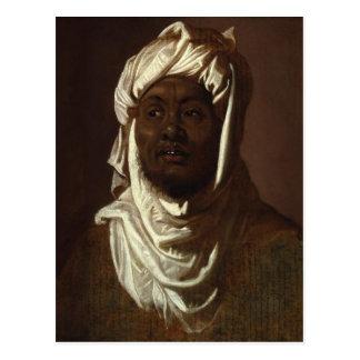 Cabeza de un hombre africano que lleva un turbante postal