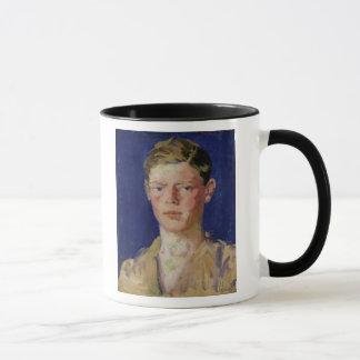 Cabeza de un hombre joven taza
