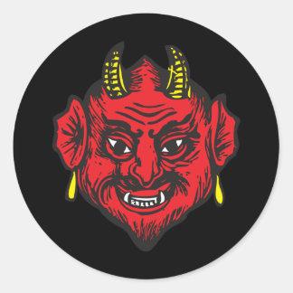 Cabeza del diablo (rojos y amarillos brillantes) pegatina redonda