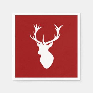 Cabeza del macho de los ciervos del navidad rojo y servilletas de papel