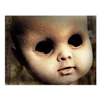 Cabeza espeluznante de la muñeca con los ojos tarjetas postales