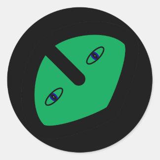 Cabeza extranjera en verde etiqueta