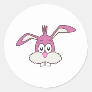 Cabeza rosada del conejo etiqueta redonda