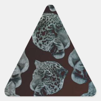 Cabezas psicodélicas rojas negras del leopardo pegatina triangular