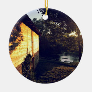 Cabin with wooden shingles next to pond ceramic ornament