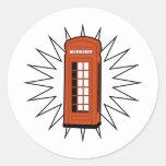 Cabina de teléfonos británica vieja etiqueta redonda