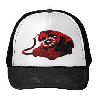 Cabina de teléfonos vieja del escritorio del arte gorra