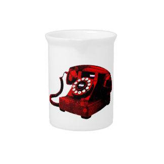 Cabina de teléfonos vieja del escritorio del arte jarra de beber