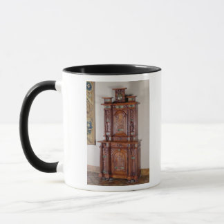 Cabinet with two sections, and a double door mug