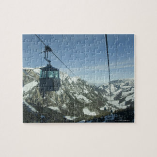 cable cars travelling through snowy mountainous puzzle