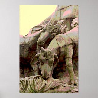 Cabra de piedra en parque que pasta el monumento impresiones