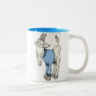 Cabra divertida en un azul y un blanco del tono de taza dos tonos