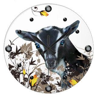 Cabra enana nigeriana que pinta el reloj de pared