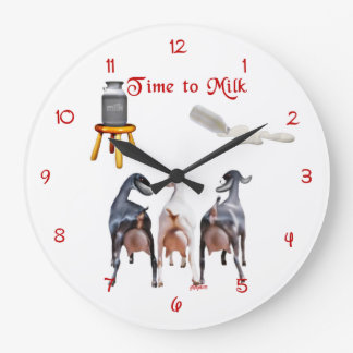 Cabras de la lechería que ordeñan el reloj de pare