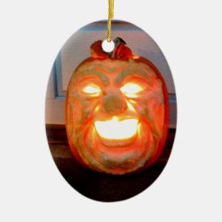 Cacareo que brilla intensamente adorno navideño ovalado de cerámica