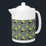 """Cacti And Roadrunners Teapot<br><div class=""""desc"""">This design pattern features Roadrunner bird silhouettes and cacti with yellow flowers. Inspired by the natural environment in a desert</div>"""