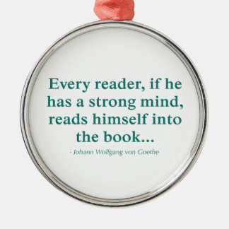 Cada lector se lee en el libro adorno redondo plateado