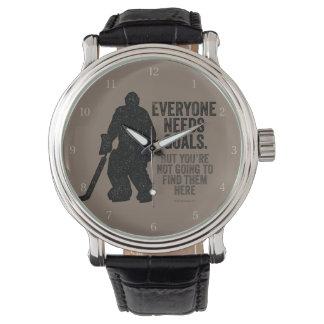 Cada uno necesita las metas (el hockey) reloj