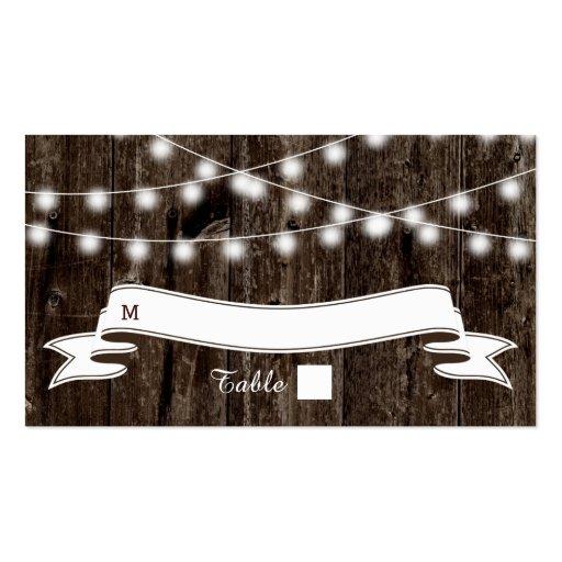 Cadena de luces en tarjeta de madera vieja del lug plantilla de tarjeta de visita