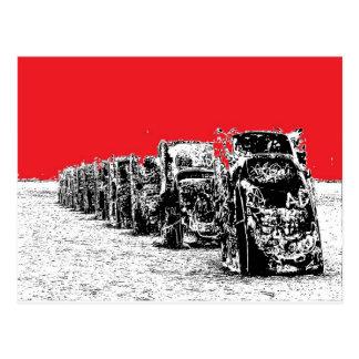 Cadillacs enterrado con el cielo rojo tarjeta postal