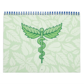 Caduceo con el fondo de las hojas calendario de pared