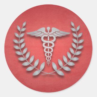 Caduceo de la Facultad de Medicina y guirnalda del Pegatinas Redondas