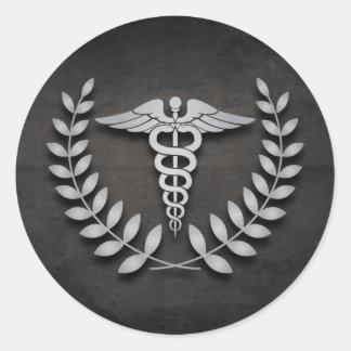 Caduceo de la Facultad de Medicina y guirnalda del Etiquetas Redondas